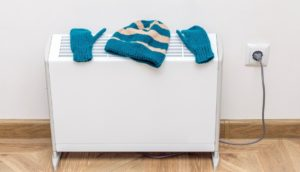 Woollen hat and gloves drying on a radiator