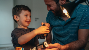 Man and son building toy