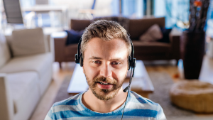 Advisor working from home with headset on