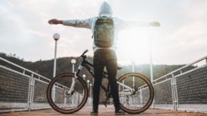 Person with bike on bridge